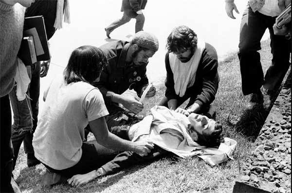 Demonstrators tend to fallen student John Cleary after he was shot and wounded by the Ohio National Guard on the campus of Kent State University May 4 1970.